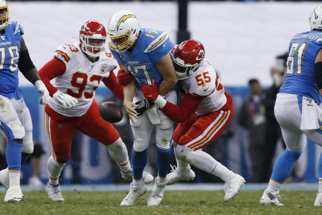 Los Angeles Chargers quarterback Philip Rivers, center, is sacked by Kansas City Chiefs defensive end Frank Clark (55) and defensive tackle Joey Ivie (93) during the second half of an NFL football game Monday, Nov. 18, 2019, in Mexico City. (AP Photo/Rebecca Blackwell)