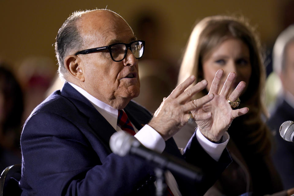 FILE - In this Nov. 25, 2020, file photo former Mayor of New York Rudy Giuliani, a lawyer for President Donald Trump, speaks at a hearing of the Pennsylvania State Senate Majority Policy Committee in Gettysburg, Pa. An appeals court suspended Giuliani from practicing law in New York because he made false statements while trying to get courts to overturn Trump's loss in the presidential race. The ruling, signed Thursday, June 24 will prevent Giuliani from representing clients as a lawyer. (AP Photo/Julio Cortez, File)