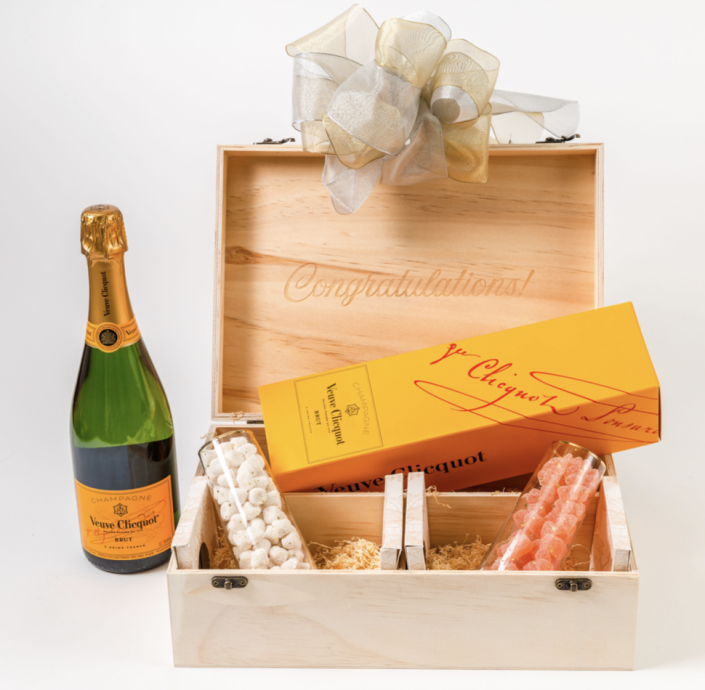 """<p><strong>GiftBasket.com</strong></p><p>giftbasket.com</p><p><strong>$149.95</strong></p><p><a href=""""https://go.redirectingat.com?id=74968X1596630&url=https%3A%2F%2Fgiftbasket.com%2Fproducts%2Fcongratulations-champagne-gift-box%3Fvariant%3D31971820273762%26gclid%3DCj0KCQjwqKuKBhCxARIsACf4XuG8eZyvV_ydr-sgR5GMTX3h4Z3LXJQvdqSM3YPE-_TuDvmaG3aThi0aAl1lEALw_wcB&sref=https%3A%2F%2Fwww.cosmopolitan.com%2Flifestyle%2Fg37682336%2Fbest-wine-gift-baskets%2F"""" rel=""""nofollow noopener"""" target=""""_blank"""" data-ylk=""""slk:Shop Now"""" class=""""link rapid-noclick-resp"""">Shop Now</a></p><p>One point for the bottle of Veuve and two points for the candy. This is a clear engagement or graduation gift, buuuuut may I also suggest sending it to the winner of your <a href=""""https://www.cosmopolitan.com/entertainment/tv/a36792552/bachelor-in-paradise-season-7-spoilers/"""" rel=""""nofollow noopener"""" target=""""_blank"""" data-ylk=""""slk:Bachelor in Paradise"""" class=""""link rapid-noclick-resp""""><em>Bachelor</em> <em>in Paradise</em></a> Bracket? What? It's a big deal!</p>"""