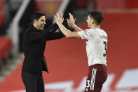 Arsenal's manager Mikel Arteta, left, celebrates with Arsenal's Kieran Tierney end of the English Premier League soccer match between Manchester United and Arsenal at the Old Trafford stadium in Manchester, England, Sunday, Nov. 1, 2020. (Paul Ellis/Pool via AP)