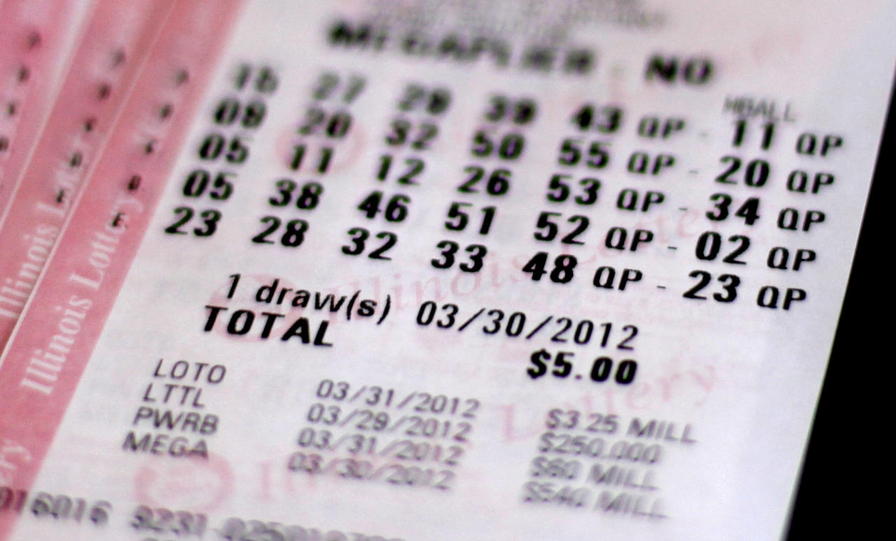 A Mega Millions lottery ticket purchased in Chicago, Thursday, March 29, 2012, shows the drawing date of Friday, March 30, 2012. With the Mega Millions jackpot over $500 million, Illinois picked the right week to become the first state in the nation to sell lottery tickets online, and other states are watching closely to see how it plays out. They're also wondering if the payoff will prompt Illinois to take the next big step: launching online poker, blackjack and other casino games.(AP Photo/Charles Rex Arbogast)
