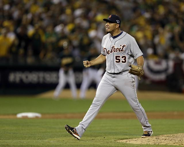 Detroit Tigers pitcher Joaquin Benoit shouts after striking out the last batter in the ninth inning for a 3-2 win over the Oakland Athletics in Game 1 of the American League baseball division series in Oakland, Calif., Friday, Oct. 4, 2013. (AP Photo/Ben Margot)