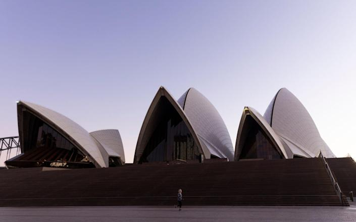 A near empty Sydney Opera House forecourt as fresh stay-at-home orders come into force in the city for two weeks - Brook Mitchell/Getty Images