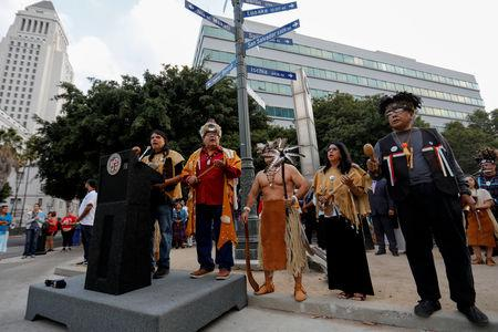 """The inaugural """"Indigenous People's Day"""" begins with a sunrise celebration in downtown Los Angeles after the Los Angeles City Council voted to establish the second Monday in October as """"Indigenous People's Day"""", replacing Columbus Day, in Los Angeles, California, U.S., October 8, 2018. REUTERS/Mike Blake"""