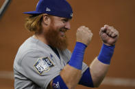 Los Angeles Dodgers third baseman Justin Turner celebrates their win against the Tampa Bay Rays in Game 3 of the baseball World Series Friday, Oct. 23, 2020, in Arlington, Texas. Dodgers beat the Rays 6-2 to lead the series 2-1 games.(AP Photo/Eric Gay)