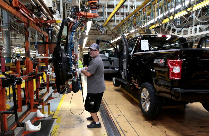 FILE PHOTO: A Ford Motor assembly worker works on a 2018 Ford F150 pick-up truck at Ford's Dearborn Truck Plant during the 100-year celebration of the Ford River Rouge Complex in Dearborn