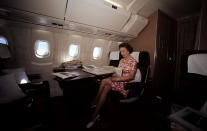 The Queen reading newspapers during her flight home from Bridgetown, Barbados, in the supersonic Concorde after her Silver Jubilee tour of Canada and the West Indies.
