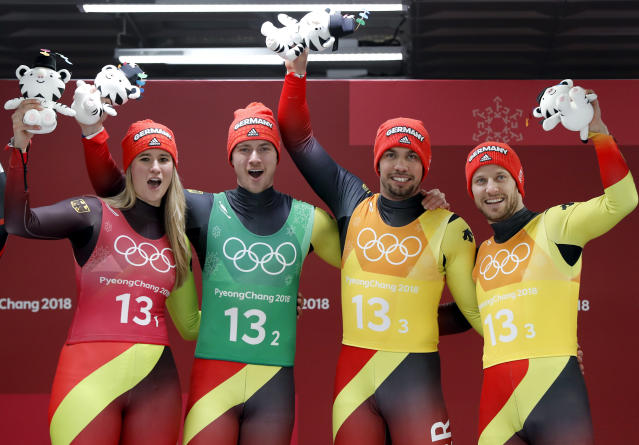 <p>From left, Natalie Geisenberger, Johannes Ludwig, Tobias Wendl and Tobias Arlt of Germany celebrates winning the gold medal in the finish area after the luge team relay at the 2018 Winter Olympics in Pyeongchang, South Korea, Thursday, Feb. 15, 2018. (AP Photo/Andy Wong) </p>