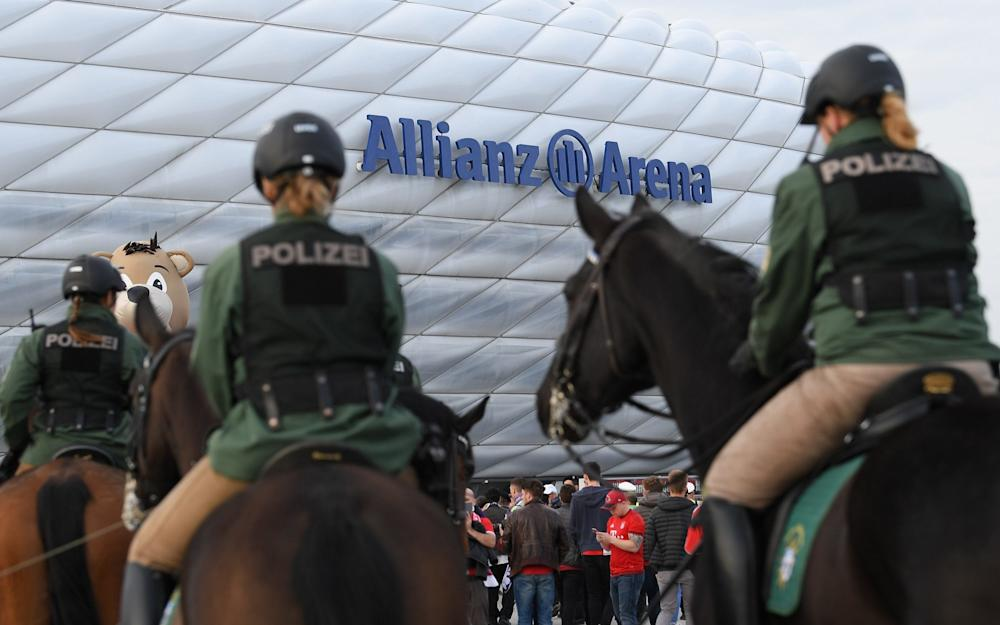 Police stand in front of the stadium prior to the UEFA Champions League Quarter Final first leg match between FC Bayern Muenchen and Real Madrid CF  - Credit: GETTY