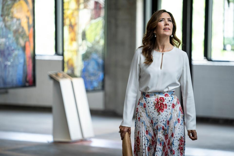 Crown Princess Mary of Denmark view artworks on June 8, 2020, while attending the opening of the designer museum Holmegaard Vaerk in Naestved some 75km south of the Danish capital Copenhagen.