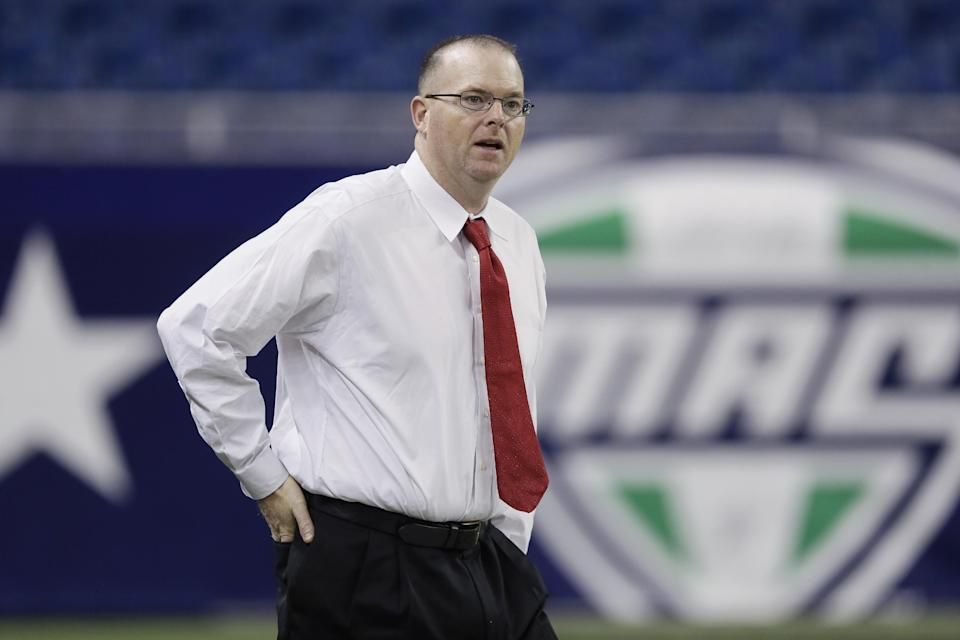 Northern Illinois head coach Rod Carey walks onto the field for NCAA college football practice in Detroit, Thursday, Dec. 4, 2014. Northern Illinois will meet Bowling Green in the Mid-American Conference Championship at Ford Field on Friday. (AP Photo/Carlos Osorio)