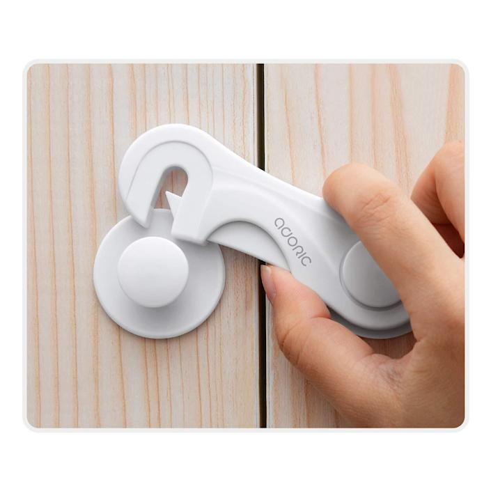 """Perfect for anyone who is just as worried about losing the cabinet key as they are worried about their baby getting into the cabinets.<br /><br /><strong>Promising review:</strong>""""These work! I know a lot of us struggle finding good child protective locks/straps but these worked on my 3-year-old.<strong>Five minutes after installing he noticed them on the bathroom cabinet and they did not budge!</strong>I recommend before you peel and stick these to make note of measurements and clean the surface where you will install. They set up and install in less than 10 minutes! A++"""" — <a href=""""https://www.amazon.com/gp/customer-reviews/R28DE5DBYGJAPH?&linkCode=ll2&tag=huffpost-bfsyndication-20&linkId=fa0e17f04dbfe17fe03846032a8a6dfc&language=en_US&ref_=as_li_ss_tl"""" target=""""_blank"""" rel=""""noopener noreferrer"""">jennifer beaulieu mcgill</a><br /><br /><strong><a href=""""https://www.amazon.com/dp/B07K2PWN19?&linkCode=ll1&tag=huffpost-bfsyndication-20&linkId=920e98f161b6578107e0838480da99dc&language=en_US&ref_=as_li_ss_tl"""" target=""""_blank"""" rel=""""noopener noreferrer"""">Get a pack of four from Amazon for $8.49.</a></strong>"""