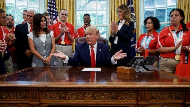 PHOTO: President Donald Trump, accompanied by Vice President Mike Pence, Karen Pence, and first lady Melania Trump, speaks during a photo opportunity with Special Olympics athletes and staff, in the Oval Office, July 18, 2019. (Alex Brandon/AP)