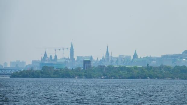 The view of the Parliament buildings, seen here from the Gatineau side of the Ottawa River, was obscured on Monday, July 26, because of smoke from wildfires in northwestern Ontario that spread across the province. (Francis Ferland/CBC News - image credit)