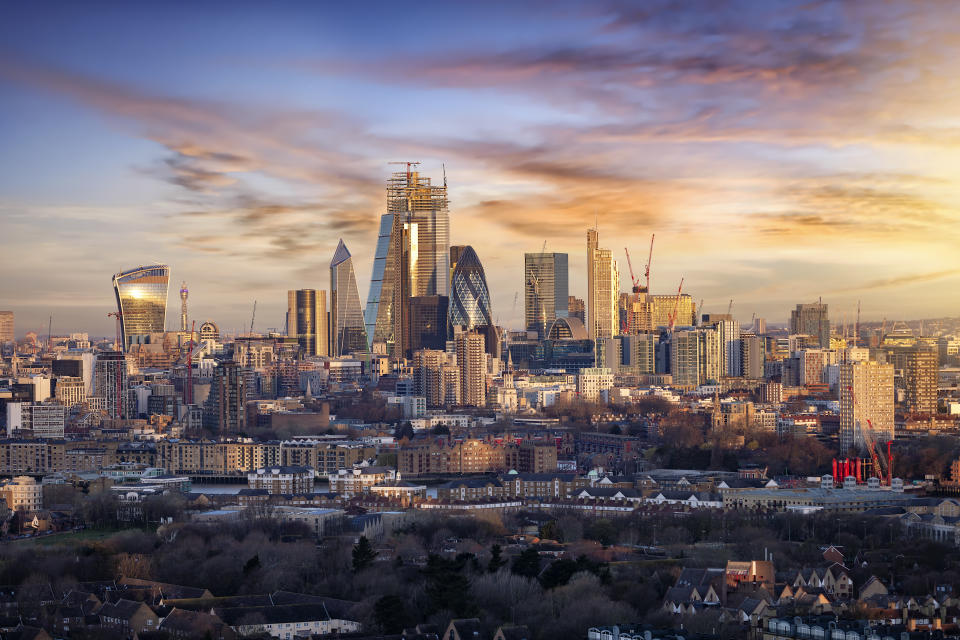 Sunrise over the urban skyline of the City of London, UK, financial district and hub of banking institutions