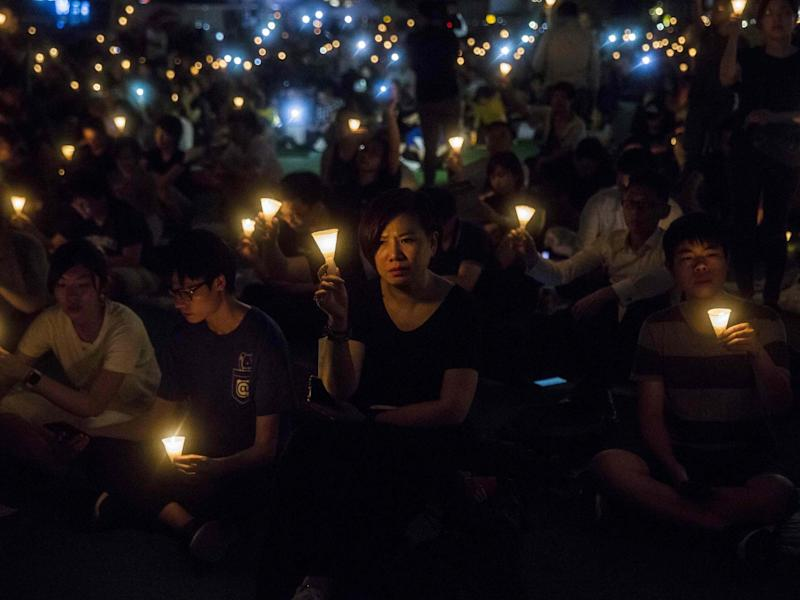 People holding candles during a vigil in Hong Kong to mark the 30th anniversary of the 1989 Tiananmen crackdown: AFP via Getty Images