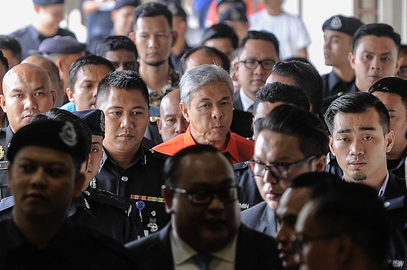 Umno president, Datuk Seri Zahid Hamidi leaves the Kuala Lumpur High Court Complex after his court hearing, October 19, 2018. — Picture by Shafwan Zaidon