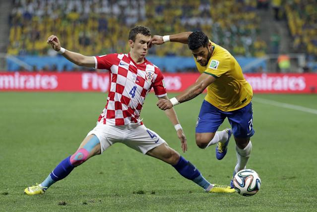 Croatia's Ivan Perisic, left, challenges Brazil's Hulk for the ball during the group A World Cup soccer match between Brazil and Croatia, the opening game of the tournament, in the Itaquerao Stadium in Sao Paulo, Brazil, Thursday, June 12, 2014. (AP Photo/Felipe Dana)