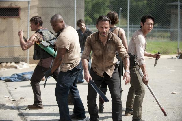 The gang fend off the walkers on the Season 3 premiere of 'The Walking Dead' -- Gene Page/AMC