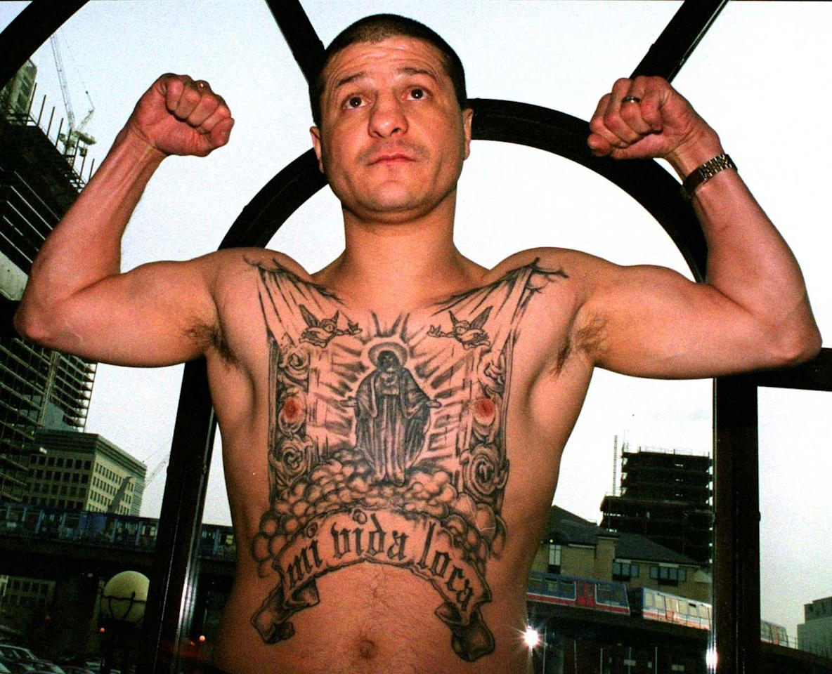 15 Jan 2002:  Jonny Tapia of Albuquerque, USA shows off his tatoo's at a Press Conference before his fight against Eduardo Alvarez of Argentina held at the International Hotel in the Docklands, London. Mandatory Credit: Warren Little/Getty Images