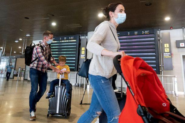 PHOTO: Passengers who were on board a Swiss Air flight from Zurich and who will be put in quarantine arrive at the airport in Valencia, Spain, May 21, 2020. (AFP via Getty Images, FILE)