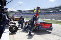 FILE - William Byron makes a pit stop during a NASCAR Cup Series auto race at Texas Motor Speedway in Fort Worth, Texas, Sunday, July 19, 2020. NASCAR has built itself around its traveling show, every weekend a super-charged event of concerts, camping and infield carousing that closes with a Cup race. The party has been canceled during the pandemic but the playoffs go on, starting Sunday, Sept. 6, without any of the pomp and circumstance. (AP Photo/Ray Carlin, File)
