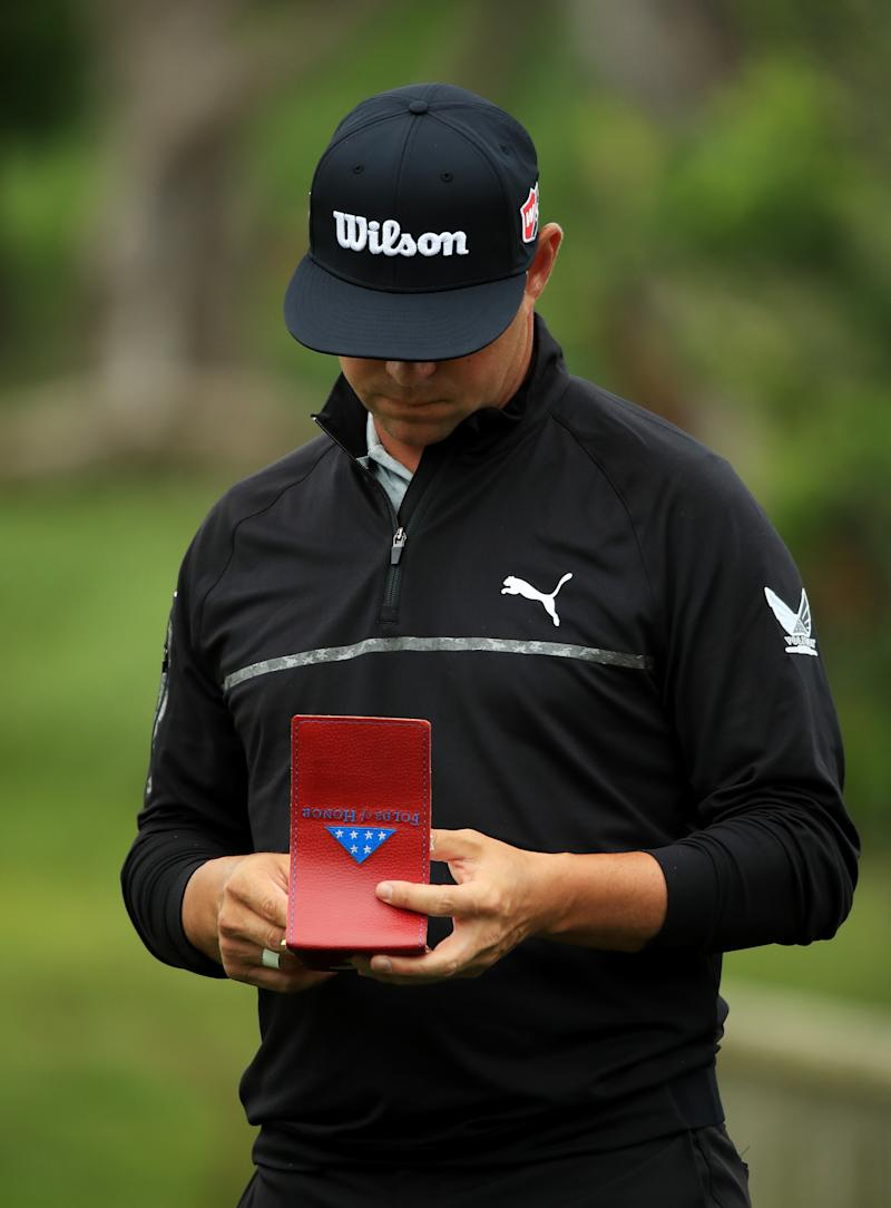 PEBBLE BEACH, CALIFORNIA - JUNE 14: Gary Woodland of the United States checks his notes on the 16th hole during the second round of the 2019 U.S. Open at Pebble Beach Golf Links on June 14, 2019 in Pebble Beach, California. (Photo by Andrew Redington/Getty Images)
