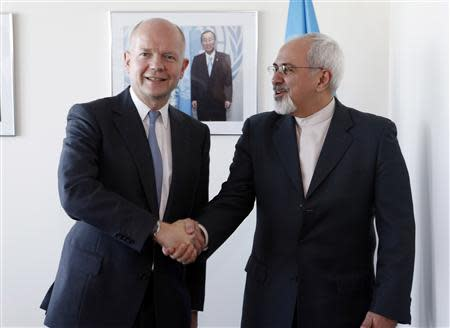 British Foreign Minister William Hague meets with Iran's Foreign Minister Mohammad Javad Zarif at the beginning of their bilateral meeting at the United Nations in New York