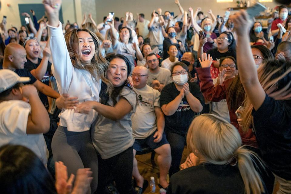 July 29, 2021: Shyenne Lee, 18, left foreground, the older sister of St. Paul Olympian Sunisa Lee, reacts alongside Souayee Vang and other family and friends as they watch Sunisa Lee clinch the gold medal in the women's Olympic gymnastics all-around at the Tokyo Olympics in Oakdale, Minn.