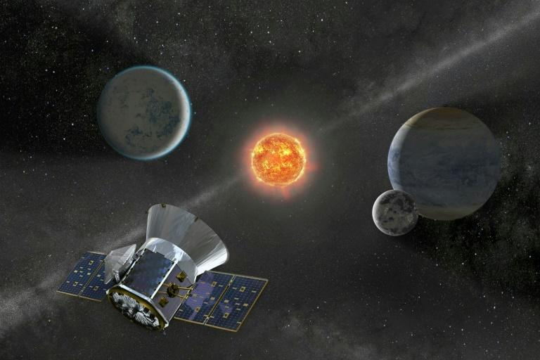NASA's Transiting Exoplanet Survey Satellite (pictured in an artist's illustration) was launched specifically to find Earth-sized planets orbiting nearby stars (AFP Photo/Handout)