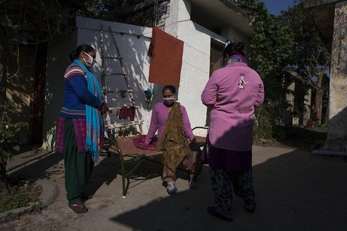 Health workers visiting homes to inform people about the vaccination