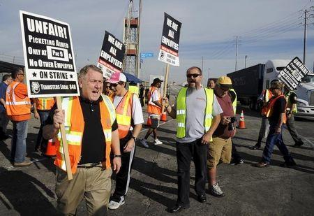 President of the International Brotherhood of Teamsters labour union James P. Hoffa walks a picket line before a news conference regarding truck drivers striking against what they say are misclassification of workers at the Ports of Long Beach and Los Angeles in Long Beach, California October 27, 2015. REUTERS/Bob Riha Jr.