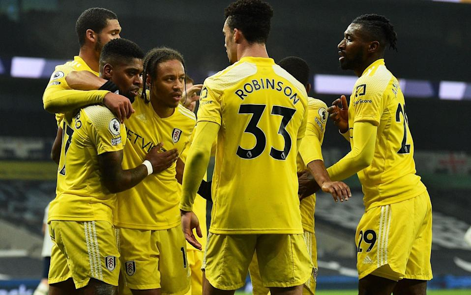 Fulham's Portuguese striker Ivan Cavaleiro celebrates scoring his team's first goal with his teammates during the English Premier League football match between Tottenham Hotspur and Fulham at Tottenham Hotspur Stadium in London, on January 13, 2021 - AFP/GLYN KIRK