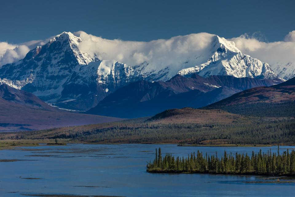 Lakes of Central Alaskan Range, Route 8, Denali Highway, Alaska, a dirt road offers stunning views of Mt. Hess Mountain, Mt. Hayes and Mt. Debora. (Photo by: Joe Sohm/Visions of America/Universal Images Group via Getty Images)