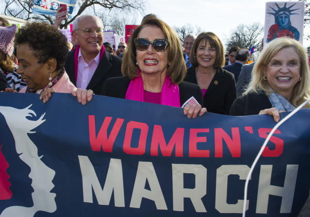 <p>House Minority Leader Nancy Pelosi, center, Rep. Susan Davis, background center right, and Rep. Carolyn Maloney, right, participate in the Women's March walk to the White House in Washington, Saturday, Jan. 20, 2018. (Photo: Cliff Owen/AP) </p>
