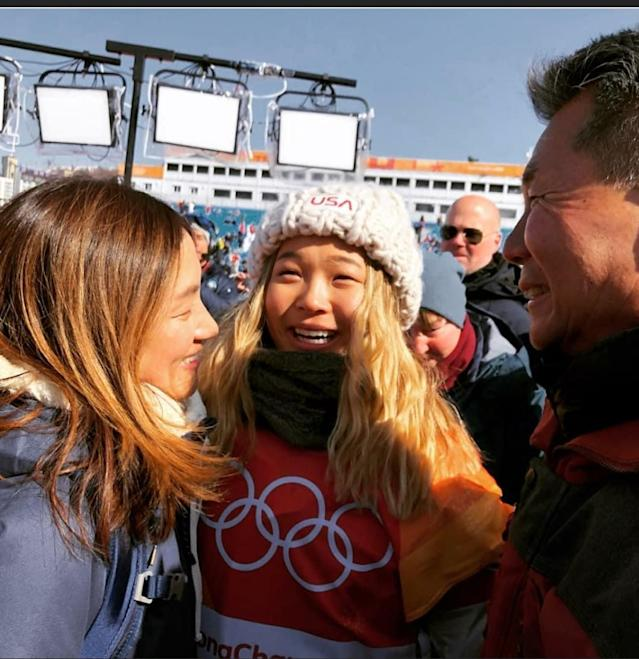 <p>Snowboarder Chloe Kim embraces her parents after winning her first gold medal. Kim's father quit his job when she was younger to dedicate himself to her snowboarding. (Instagram | @chloekimsnow) </p>