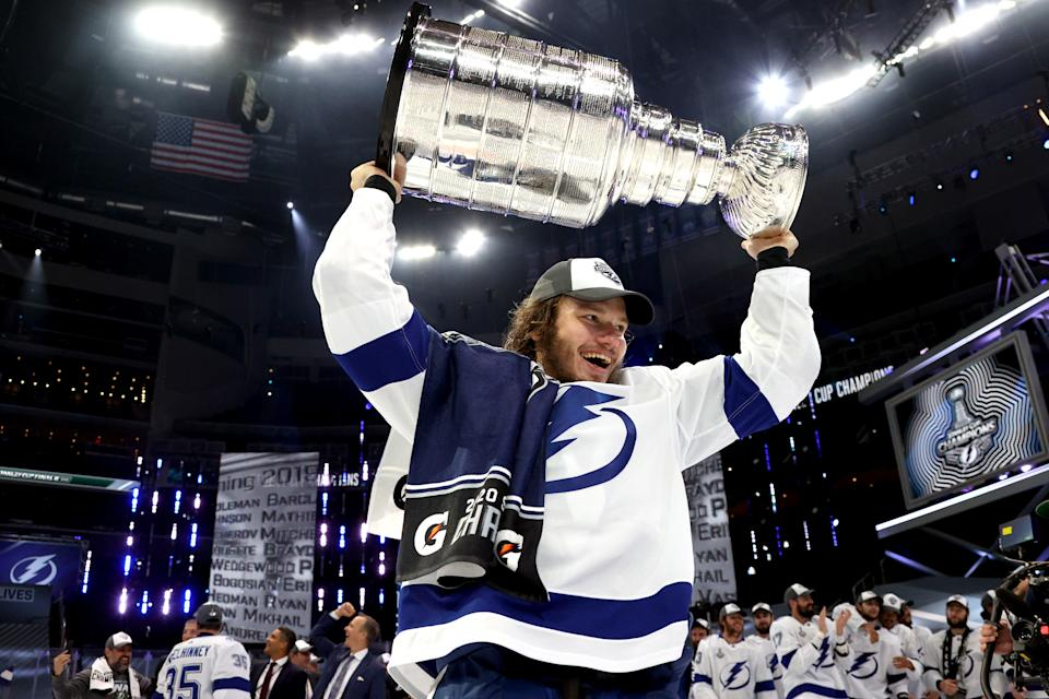 EDMONTON, ALBERTA - SEPTEMBER 28: Mikhail Sergachev #98 of the Tampa Bay Lightning hoists the Stanley Cup overhead after the  Tampa Bay Lightning defeated the Dallas Stars 2-0 in Game Six of the NHL Stanley Cup Final to win the best of seven game series 4-2 at Rogers Place on September 28, 2020 in Edmonton, Alberta, Canada. (Photo by Dave Sandford/NHLI via Getty Images)