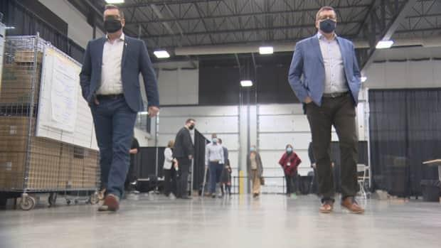 Health Minister Paul Merriman (left) and Premier Scott Moe tour the mass vaccination clinic at the International Trade Centre at Regina's Evraz Place.