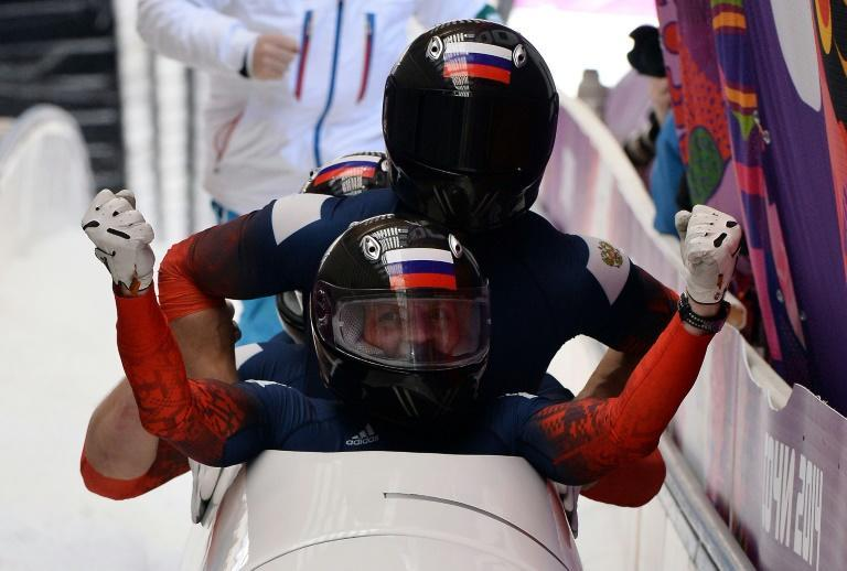 Alexander Zubkov celebrates the gold medal run in the four-man bobsleigh in Sochi but Russia was later stripped of the medal and Zubkov banned
