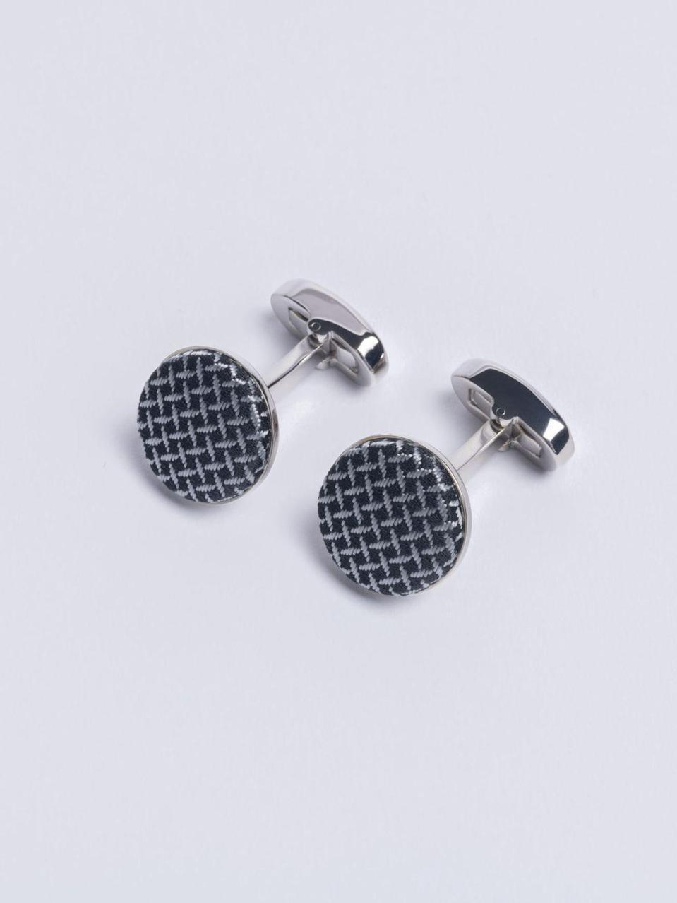 """<p>You can't really go wrong with a suave tie and a pair of cufflinks, especially now the offices are opening back up again. For something a little more special, Henry Poole of Savile Row stocks some of the best out there. Our pick of the bunch are the Silver Cundey cufflinks. Chic and snazzy, the signature weave engraved with the house's namesake can also be matched with a weave tie.. </p><p>From £75, <a href=""""https://henrypoole.com/shop/"""" rel=""""nofollow noopener"""" target=""""_blank"""" data-ylk=""""slk:Henry Poole"""" class=""""link rapid-noclick-resp"""">Henry Poole</a>.</p>"""