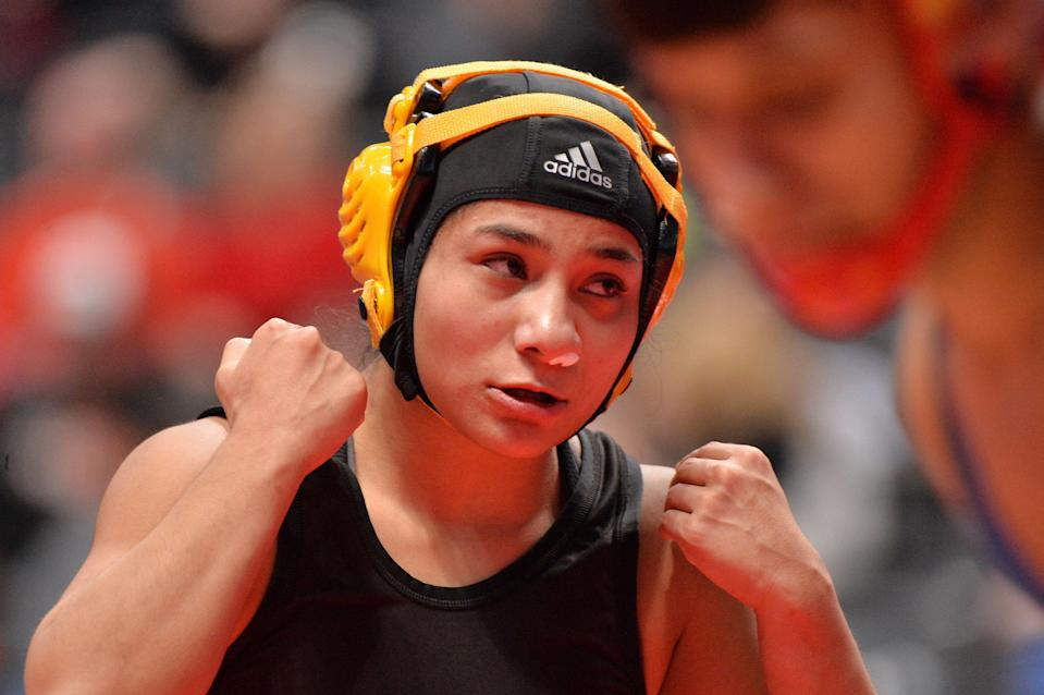 Angel Rios was one of two female wrestlers who placed in the Colorado state tournament for the first time.