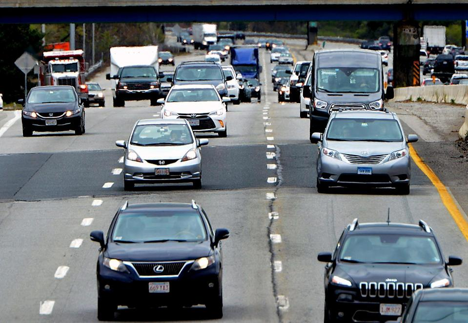 """Heavy traffic travels on the Mass Pike in Natick in 2019. State Highway Administrator Jonathan Gulliver said that highway traffic, """"for all intents and purposes, is back to about 2019 levels on most roadways in Massachusetts."""""""