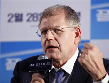 "Director Zemeckis speaks to media during a news conference to promote his movie ""Flight"" at a hotel in Seoul"