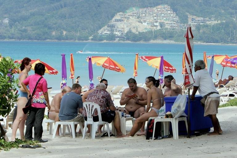 Foreigners are seen relaxing at the Patong beach in Phuket, southern Thailand, on December 23, 2005. An estimate suggests that by 2050 Asia will account for 63 percent of the world's senior citizens, who will become increasingly important to economies, especially as medical advances extend lifespans