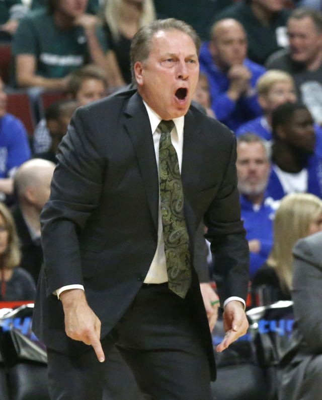Michigan State coach Tom Izzo yells at his team during the first half of an NCAA college basketball game against Kentucky on Tuesday, Nov. 12, 2013, in Chicago. (AP Photo/Charles Rex Arbogast)