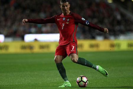 Portugal v Hungary - World Cup 2018 Qualifiers European Zone - Group B - Luz Stadium, Lisbon, Portugal - 25/03/17 - Portugal's Cristiano Ronaldo shooting for the goal. REUTERS/Pedro Nunes