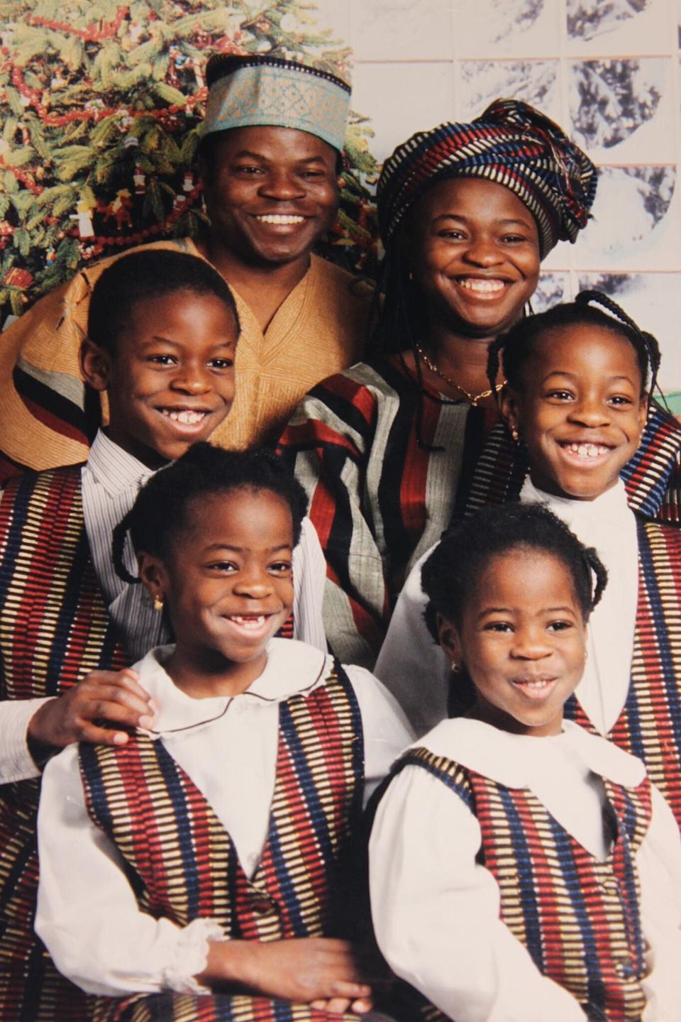 The writer's family wearing traditional Nigerian outfits. (Photo: Tomi Ajele)