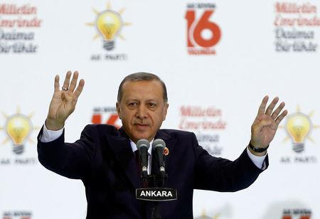 Turkish President Erdogan greets the audience during a ceremony to mark the 16th anniversary of his ruling AK Party's foundation in Ankara
