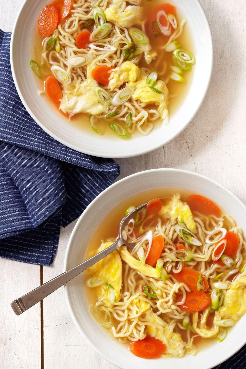 """<p>Use quick-cooking ramen and store-bought chicken broth to get this hearty rendition of the Chinese-restaurant classic on the table in a jiffy. Fortune cookies optional.</p><p><strong><a href=""""https://www.countryliving.com/food-drinks/recipes/a4891/egg-drop-noodle-soup-recipe-clv0214/"""" rel=""""nofollow noopener"""" target=""""_blank"""" data-ylk=""""slk:Get the recipe"""" class=""""link rapid-noclick-resp"""">Get the recipe</a>.</strong></p>"""