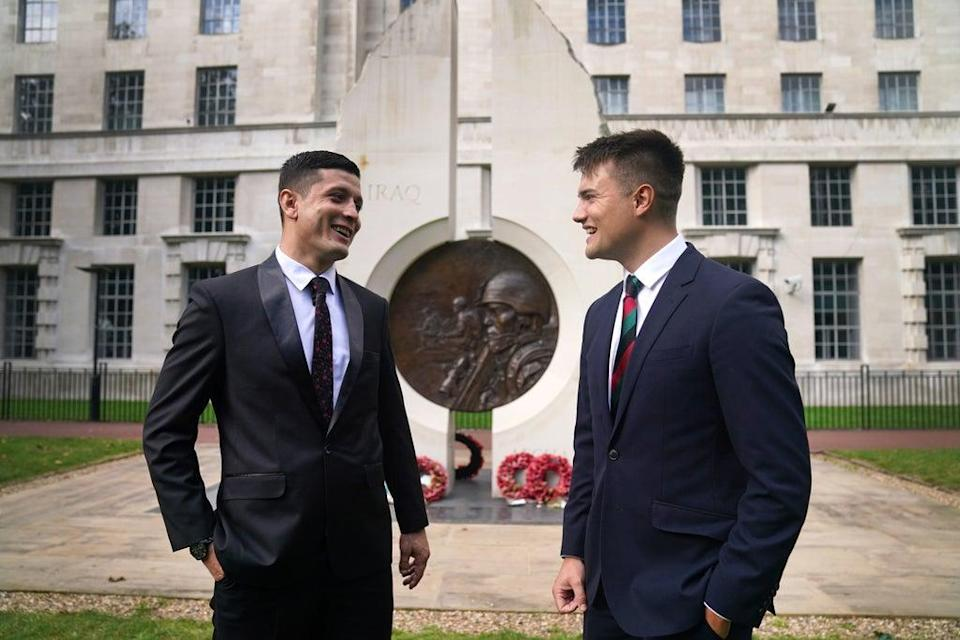 First Lieutenant Mohammad Jawad Akbari and Captain Dave Kellett talk to each other by the Iraq Afghanistan Memorial at the Ministry of Defence building in Westminster (Victoria Jones/PA) (PA Wire)